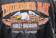 back of black leather jacket with Thunder Bay Harley Davidson logo and eagle on it