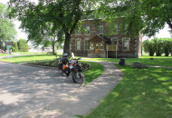 motorcyle parked in front of old stone building