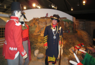 man dressed in old fashioned military apparel in museum