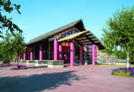 information centre with bright pink pillars and wooden building
