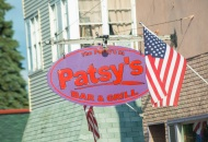 purple and red oval sign for patsy's bar & grill
